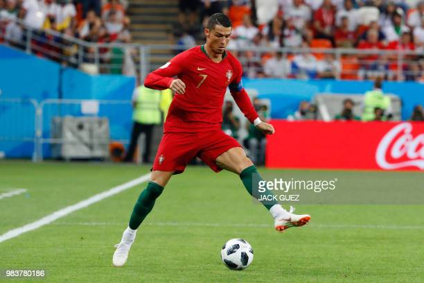 Portugal's forward Cristiano Ronaldo dribbles with the ball during the Russia 2018 World Cup Group B football match between Iran and Portugal at the...
