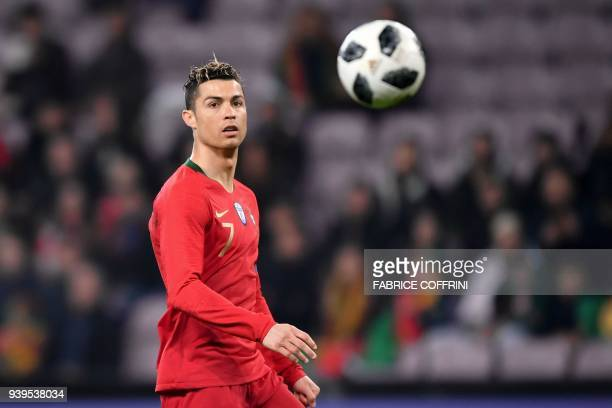 Portugal's forward Cristiano Ronaldo eyes the ball during the international friendly football match between Portugal and Netherlands at Stade de...