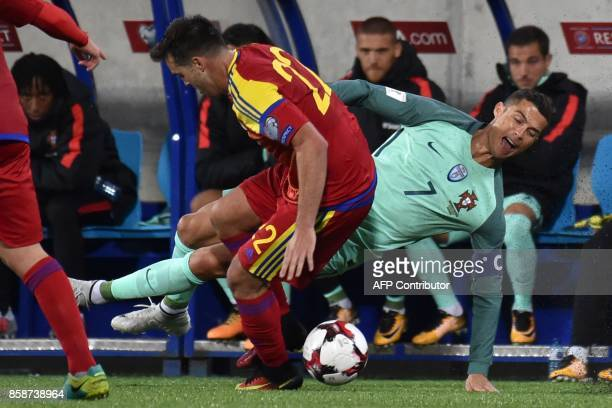 Portugal's forward Cristiano Ronaldo falls while challenging Andorra's midfielder Victor Rodriguez during the FIFA World Cup 2018 football qualifier...