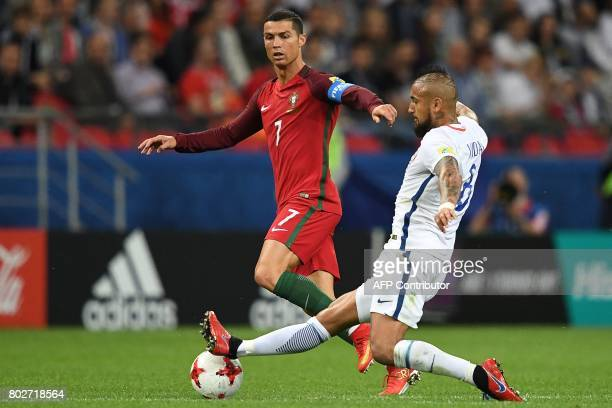 TOPSHOT Portugal's forward Cristiano Ronaldo fights for the ball against Chile's midfielder Arturo Vidal during the 2017 Confederations Cup semifinal...