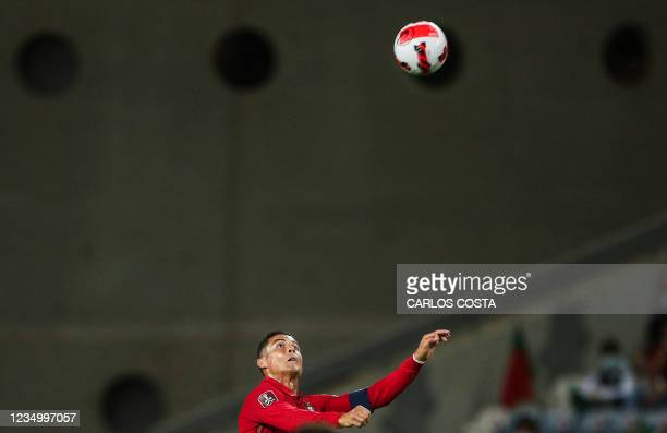 Portugal's forward Cristiano Ronaldo fights for the ball during the FIFA World Cup Qatar 2022 European qualifying round group A football match...