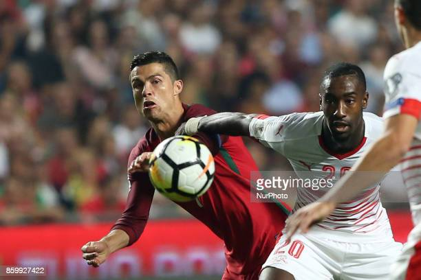 Portugal's forward Cristiano Ronaldo fights for the ball with Switzerland's defender Johan Djourou during the 2018 FIFA World Cup qualifying football...