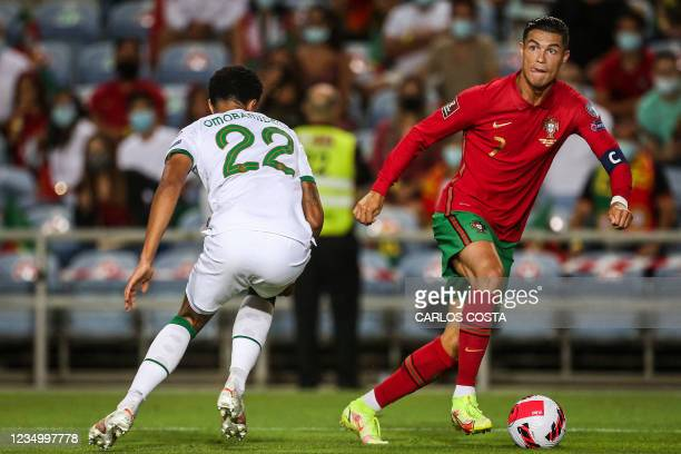 Portugal's forward Cristiano Ronaldo fights for the ball with Republic of Ireland's defender Andrew Omobamidele during the FIFA World Cup Qatar 2022...