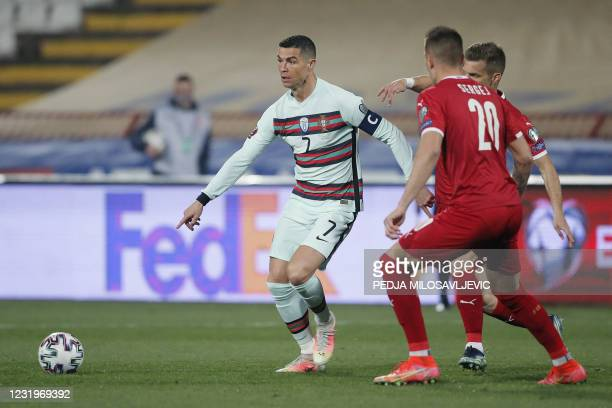 Portugal's forward Cristiano Ronaldo fights for the ball with Serbia's midfielder Sergej Milinkovic-Savic during the FIFA World Cup Qatar 2022...