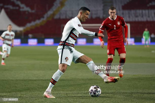 Portugal's forward Cristiano Ronaldo fights for the ball with Serbia's defender Strahinja Pavlovic during the FIFA World Cup Qatar 2022 qualification...