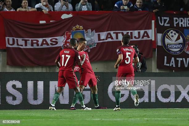 Portugal's forward Cristiano Ronaldo from Portugal celebrates scoring Portugal's first goal with Portugal's forward Nani from Portugal and Portugal's...