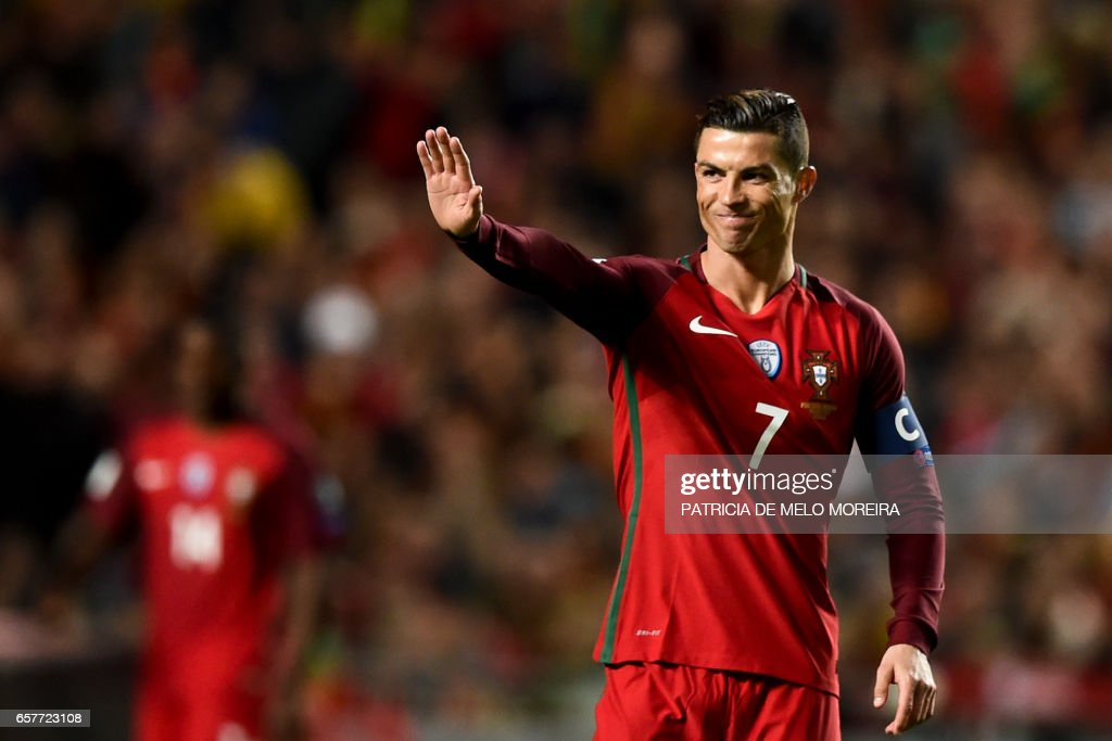 Portugal's forward Cristiano Ronaldo gestures after missing a goal opportunity during the WC 2018 group B football qualifing match Portugal vs Hungary at the Luz stadium in Lisbon on March 25, 2017. /