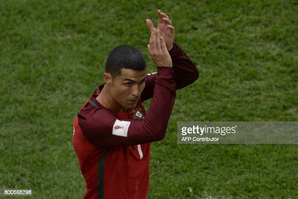 Portugal's forward Cristiano Ronaldo gestures as he leaves the pitch after being substituted during the 2017 Confederations Cup group A football...
