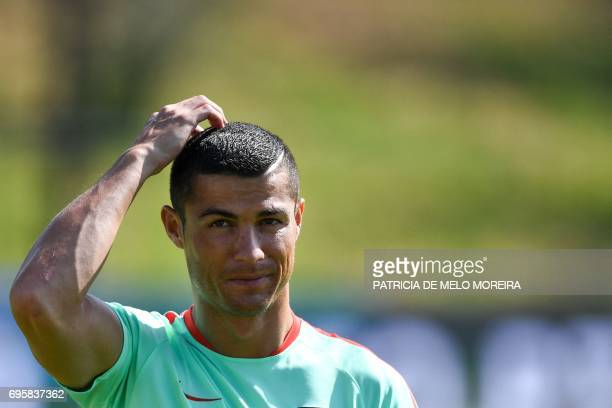 Portugal's forward Cristiano Ronaldo gestures during a training session at 'Cidade do Futebol' training camp in Oeiras outskirts of Lisbon on June 14...