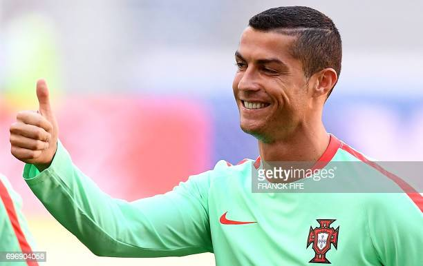 Portugal's forward Cristiano Ronaldo gestures during a training session at the Kazan Arena stadium in Kazan Russia on June 17 2017 on the eve of the...