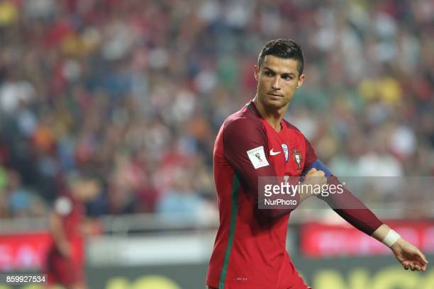 Portugal's forward Cristiano Ronaldo gestures during the 2018 FIFA World Cup qualifying football match between Portugal and Switzerland at the Luz...
