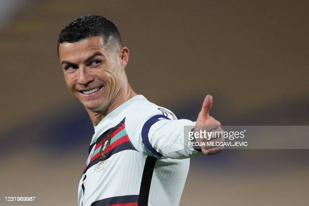 Portugal's forward Cristiano Ronaldo gestures during the FIFA World Cup Qatar 2022 qualification Group A football match between Serbia and Portugal...