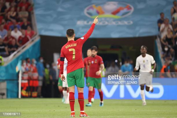 Portugal's forward Cristiano Ronaldo gestures during the UEFA EURO 2020 Group F football match between Portugal and France at Puskas Arena in...