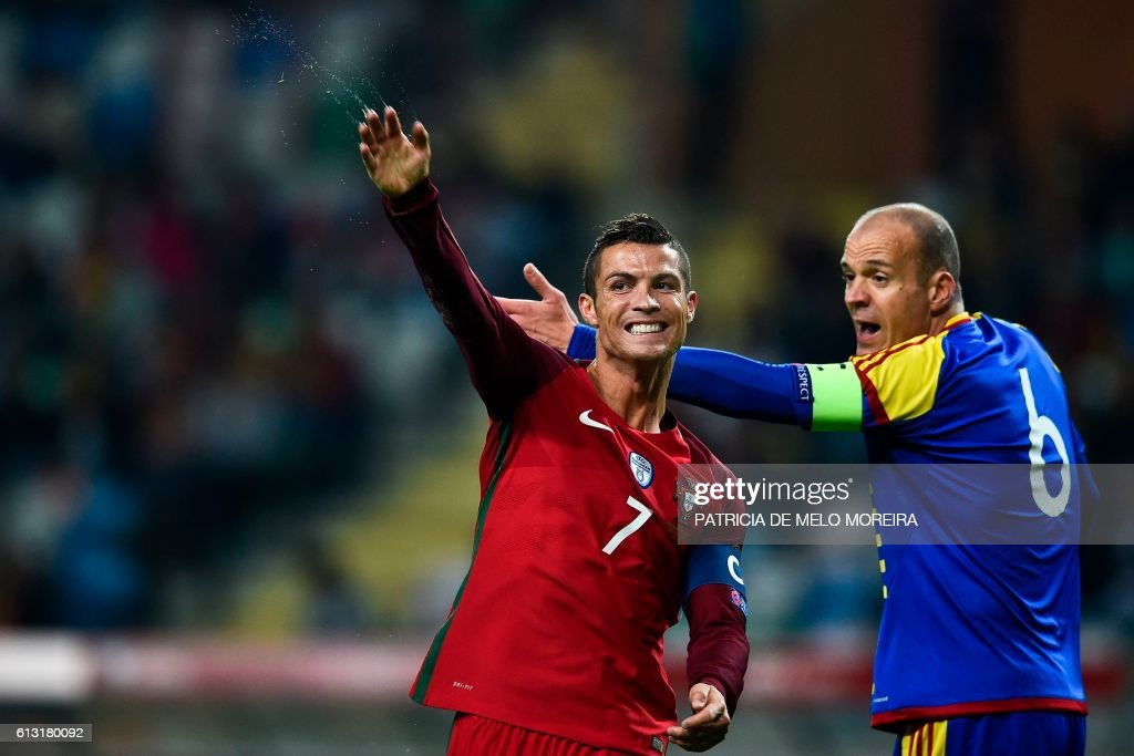 Portugal's forward Cristiano Ronaldo (L) gestures during the WC 2018 football qualification match between Portugal and Andorra at the Municipal de Arouca stadium in Aveiro on October 7, 2016. MOREIRA
