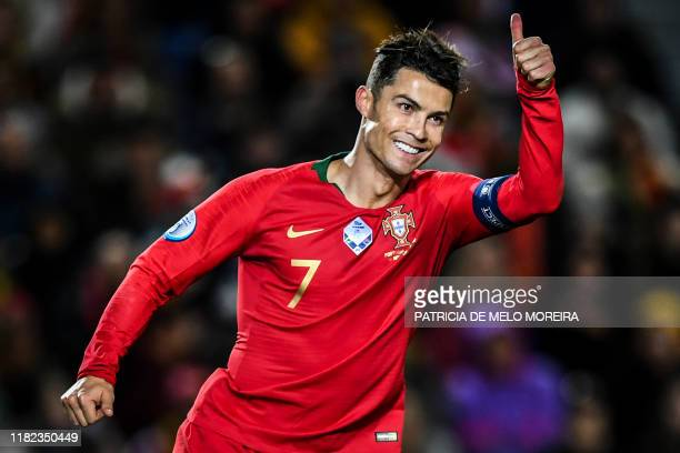 TOPSHOT Portugal's forward Cristiano Ronaldo gives the thumb up during the Euro 2020 Group B football qualification match between Portugal and...