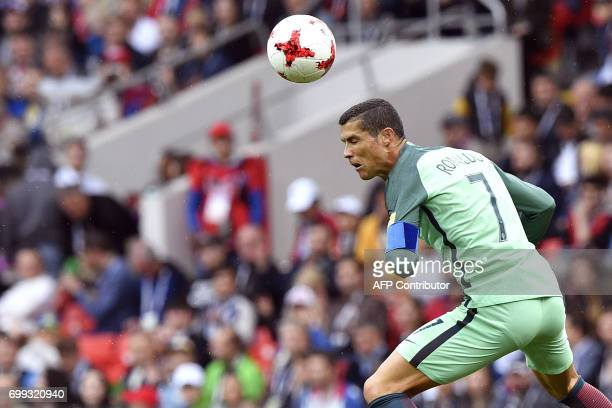 TOPSHOT Portugal's forward Cristiano Ronaldo heads the ball during the 2017 Confederations Cup group A football match between Russia and Portugal at...