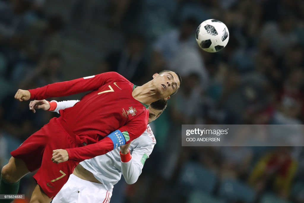TOPSHOT - Portugal's forward Cristiano Ronaldo heads the ball during the Russia 2018 World Cup Group B football match between Portugal and Spain at the Fisht Stadium in Sochi on June 15, 2018. (Photo by Odd ANDERSEN / AFP) / RESTRICTED