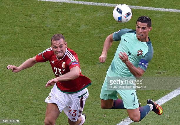 Portugal's forward Cristiano Ronaldo heads the ball to score a goal during the Euro 2016 group F football match between Hungary and Portugal at the...