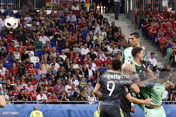 Portugal's forward Cristiano Ronaldo heads the ball to score the team's first goal during the Euro 2016 semifinal football match between Portugal and...