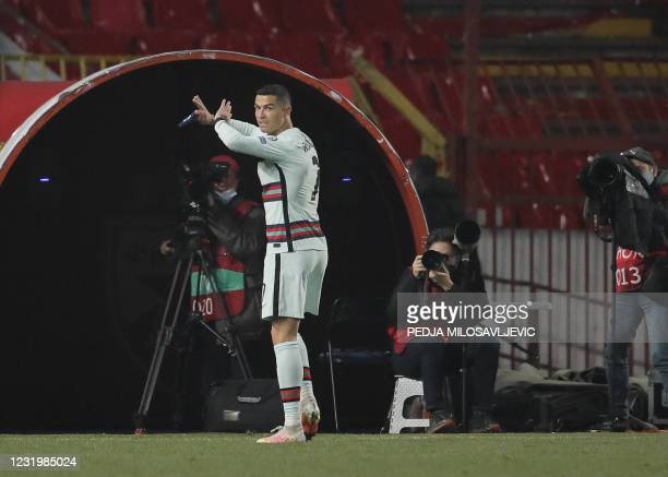Portugal's forward Cristiano Ronaldo holds his captain armband moments before he threw it to the ground and left the pitch at the end of the FIFA...