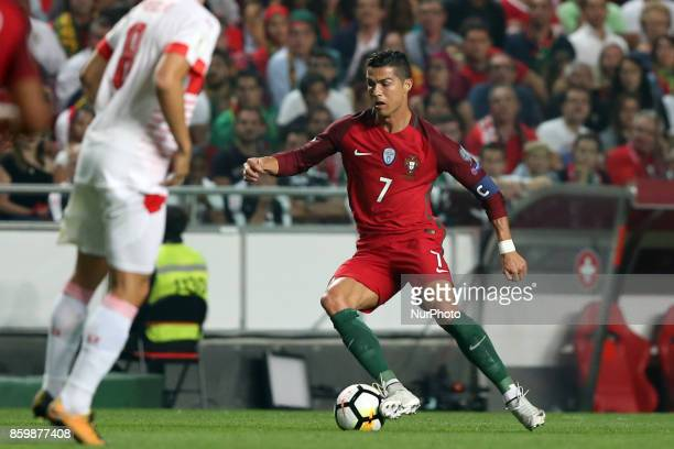 Portugal's forward Cristiano Ronaldo in action during the 2018 FIFA World Cup qualifying football match between Portugal and Switzerland at the Luz...
