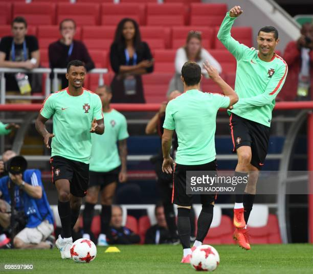 Portugal's forward Cristiano Ronaldo jumps next to Portugal's forward Nani during a training session in Moscow on June 20 2017 on the eve of the 2017...