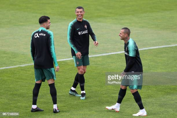 Portugal's forward Cristiano Ronaldo laughs with Portugal's forward Ricardo Quaresma and Portugal's defender Pepe during a training session at Cidade...
