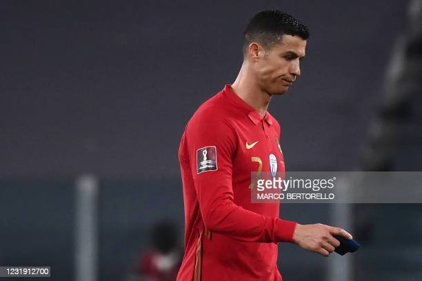 Portugal's forward Cristiano Ronaldo leaves the pitch at the end of the FIFA World Cup Qatar 2022 qualification football match between Portugal and...