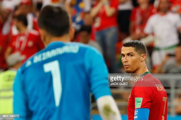 TOPSHOT Portugal's forward Cristiano Ronaldo looks at Iran's goalkeeper Alireza Beiranvand after missing a penalty during the Russia 2018 World Cup...
