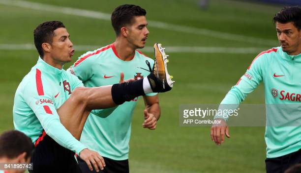 Portugal's forward Cristiano Ronaldo Portugal's Andre Silva and Jose Fonte take part in a training session at the last training on the eve of the...