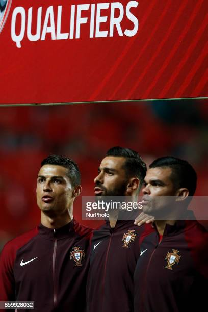 Portugal's forward Cristiano Ronaldo Portugal's goalkeeper Rui Patricio and Portugal's defender Pepe sing the Portuguese national anthem during the...