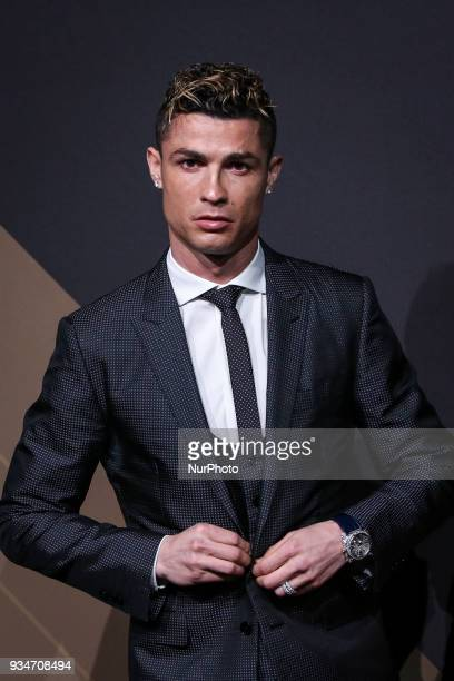 Portugal's forward Cristiano Ronaldo poses on arrival at quotQuinas de Ouroquot ceremony held at Pavilhao Carlos Lopes in Lisbon on March 19 2018...