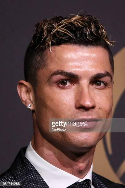 Portugal's forward Cristiano Ronaldo poses on arrival at 'Quinas de Ouro' ceremony held at Pavilhao Carlos Lopes in Lisbon on March 19 2018