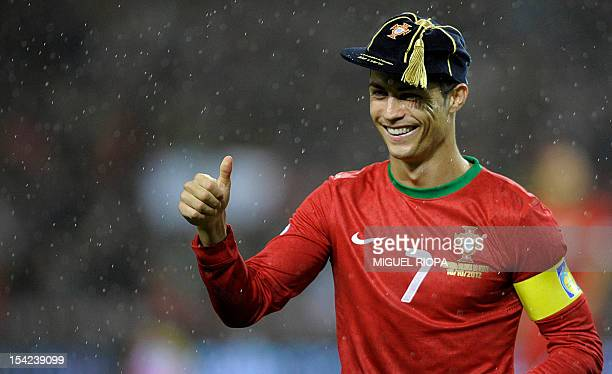 Portugal's forward Cristiano Ronaldo poses with a special cap for his 100th appearance with the Portuguese national team before the FIFA World Cup...