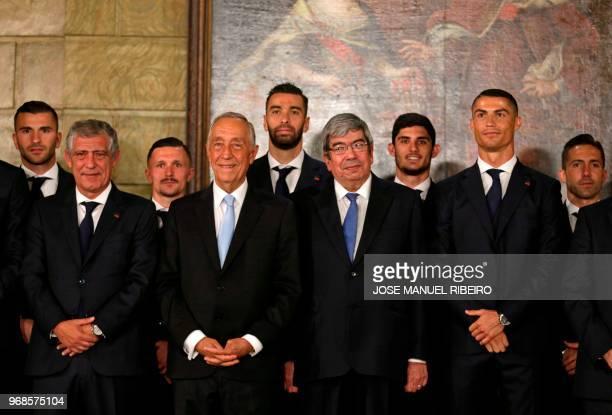 Portugal's forward Cristiano Ronaldo poses with teammates and Portuguese parliament spaeker Ferro Rodrigues , Portuguese President Marcelo Rebelo de...