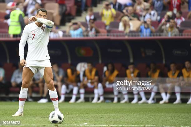 TOPSHOT Portugal's forward Cristiano Ronaldo prepares to shoot a free kick during the Russia 2018 World Cup Group B football match between Portugal...