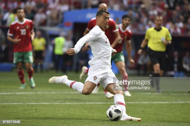 Portugal's forward Cristiano Ronaldo prepares to shoot the ball during the Russia 2018 World Cup Group B football match between Portugal and Morocco...