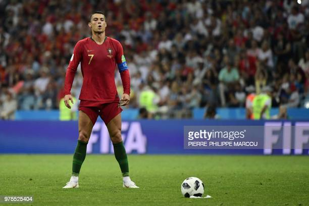 Portugal's forward Cristiano Ronaldo prepares to take a freekick during the Russia 2018 World Cup Group B football match between Portugal and Spain...