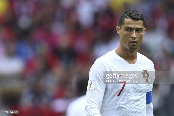 Portugal's forward Cristiano Ronaldo reacts after scoring a goal during the Russia 2018 World Cup Group B football match between Portugal and Morocco...