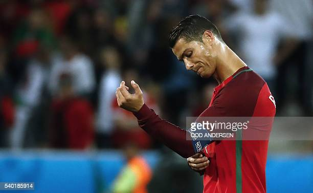 Portugal's forward Cristiano Ronaldo reacts after the Euro 2016 group F football match between Portugal and Iceland at the GeoffroyGuichard stadium...