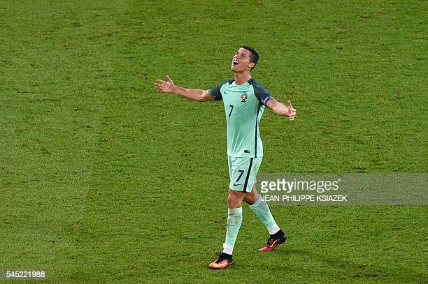 TOPSHOT Portugal's forward Cristiano Ronaldo reacts after the Euro 2016 semifinal football match between Portugal and Wales at the Parc Olympique...