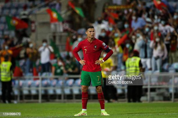 Portugal's forward Cristiano Ronaldo reacts after the FIFA World Cup Qatar 2022 European qualifying round group A football match between Portugal and...