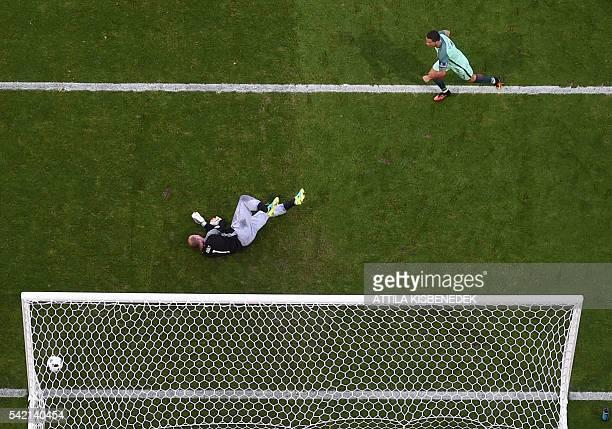 TOPSHOT Portugal's forward Cristiano Ronaldo reacts as he scores a goal past Hungary's goalkeeper Gabor Kiraly during the Euro 2016 group F football...