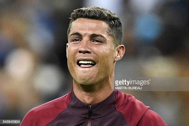 TOPSHOT Portugal's forward Cristiano Ronaldo reacts as Portugal beats France 10 to clinch the Euro 2016 final football match between France and...