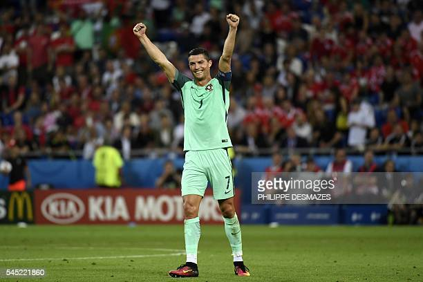 Portugal's forward Cristiano Ronaldo reacts as Portugal clinches the match 20 against Wales in the Euro 2016 semifinal football match between...