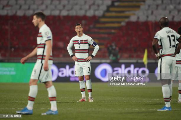 Portugal's forward Cristiano Ronaldo reacts at the end of the FIFA World Cup Qatar 2022 qualification Group A football match between Serbia and...