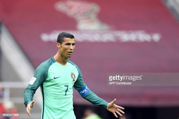 Portugal's forward Cristiano Ronaldo reacts during the 2017 Confederations Cup group A football match between Russia and Portugal at the Spartak...