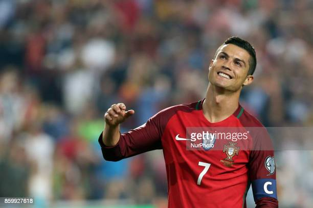 Portugal's forward Cristiano Ronaldo reacts during the 2018 FIFA World Cup qualifying football match between Portugal and Switzerland at the Luz...