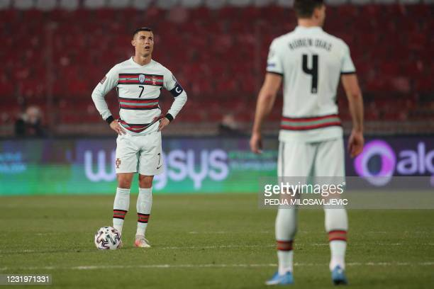 Portugal's forward Cristiano Ronaldo reacts during the FIFA World Cup Qatar 2022 qualification Group A football match between Serbia and Portugal at...