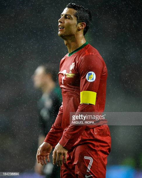 Portugal's forward Cristiano Ronaldo reacts during the FIFA World Cup 2014 qualifying football match Portugal vs Northern Ireland at the Dragao...